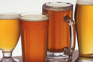 Photo of assorted mugs and glasses of beer.